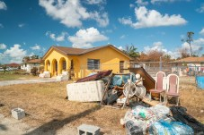 Keys Weekly photographer documents Bahamas plight - A person sitting in front of a house - Florida Keys