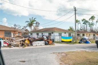 Keys Weekly photographer documents Bahamas plight - A truck is parked on the side of a road - Florida Keys