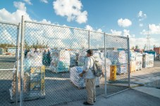 Keys Weekly photographer documents Bahamas plight - A man standing next to a fence - Florida Keys