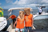 GOLFIN' CONCH STYLE – Funds raised for school, community programs - A group of people on a boat in the water - Boat