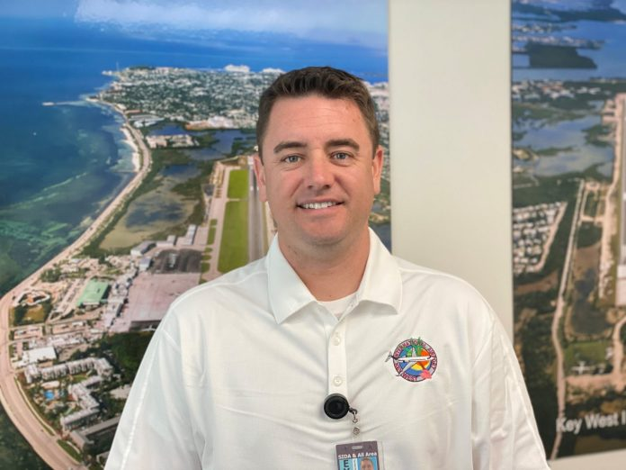 Erick D'Leon starts as new Assistant Director of Airports for Key West, Marathon - A man standing in front of a body of water - Tourism