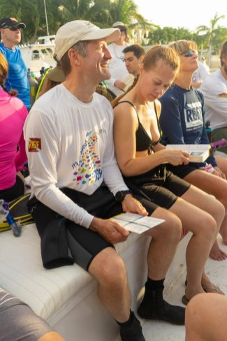 CELEBRATING CONSERVATION DECK: REEF Fest brings education, adventure - A group of people sitting on a couch - Car