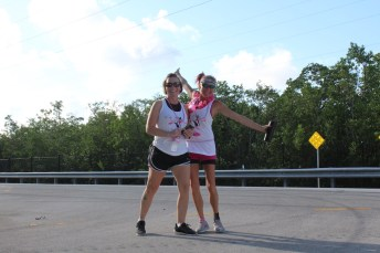 PINK ARMY – Inaugural bra walk in Key Largo sees large support - A woman walking down a road - Car