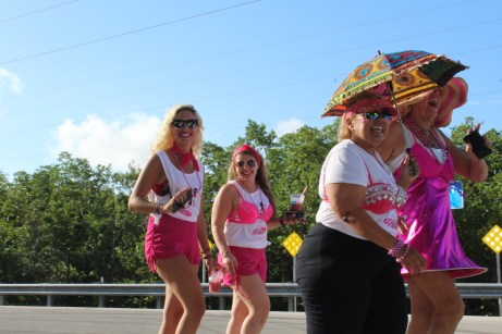 PINK ARMY – Inaugural bra walk in Key Largo sees large support - A couple of people that are standing in a parking lot - Vacation