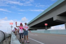 PINK ARMY – Inaugural bra walk in Key Largo sees large support - A man riding a skateboard up the side of a building - Lane