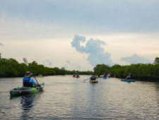 CELEBRATING CONSERVATION DECK: REEF Fest brings education, adventure - A group of people in a small boat in a body of water - Sea kayak