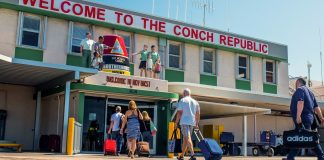 Direct Flights from Boston Logan Airport to Key West - A group of people standing in front of a store - Key West International Airport