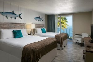 Islamorada RPostcard Inn Oceanfront Roomesorts Named Condé Nast Traveler Best in Florida Keys - A bedroom with a large bed in a hotel room - Postcard Inn Beach Resort and Marina at Holiday Isle