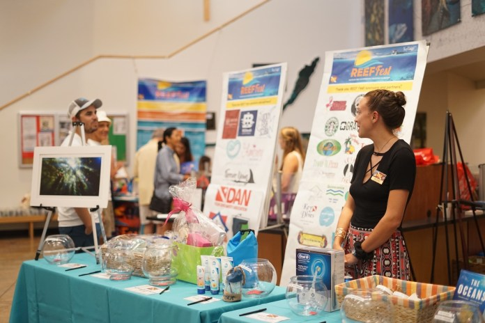 REEF Fest to offer diving, socials and more - A person standing in a kitchen - Product