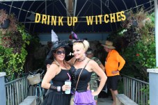 BROOMSTICK PARKING ONLY –AnnualWitches'Ride raises funds for cancer research - A person standing in front of a fence - Vacation