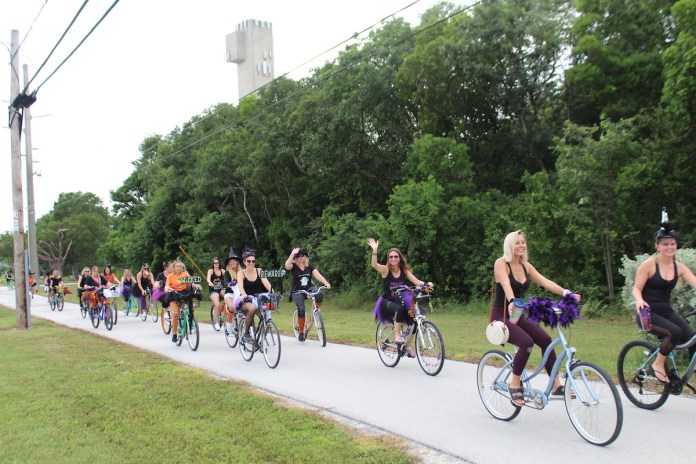 BROOMSTICK PARKING ONLY – Annual Witches' Ride raises funds for cancer research - A group of people riding on the back of a bicycle - Road bicycle racing