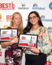 The Best of Marathon 2019 Winners in Pictures - A man and a woman holding a sign - Keys Federal Credit Union