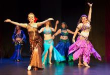 A group of people wearing costumes - Modern dance