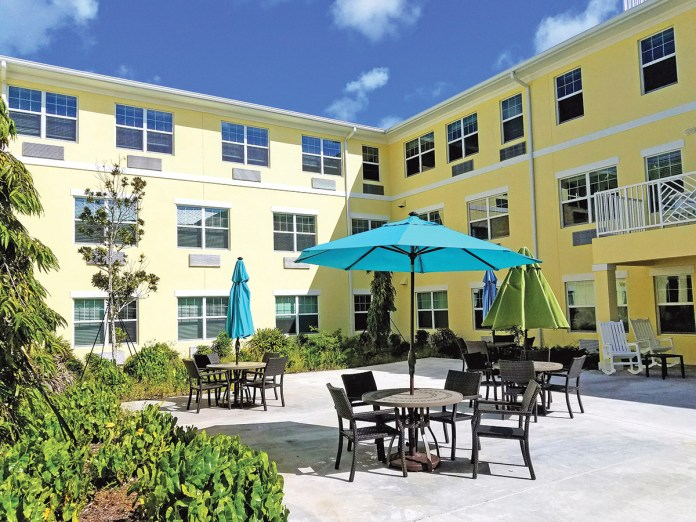 A courtyard in the middle of the Poinciana Gardens independent and assisted-living apartments welcomes residents to enjoy the shaded outdoors and is used for many of the activities planned by Activities Director Shathi Islam. MANDY MILES/ Keys Weekly