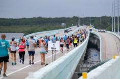 A group of people running on a bridge - Marathon