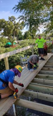 Guess what? Habitat is still helping homeowners recover from Irma - A group of people sitting on a wooden bench - Leisure