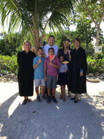 Wesley House celebrates Adoption Day - A group of people standing next to a tree - Social group