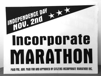 Celebrating 20 years: Marathon's roots traced back to property rights - A close up of text on a black background - Banner