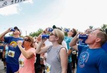 RUN, DRINK, RUN – Spots almost filled or annual Islamorada race - A group of people standing in front of a crowd - Half marathon