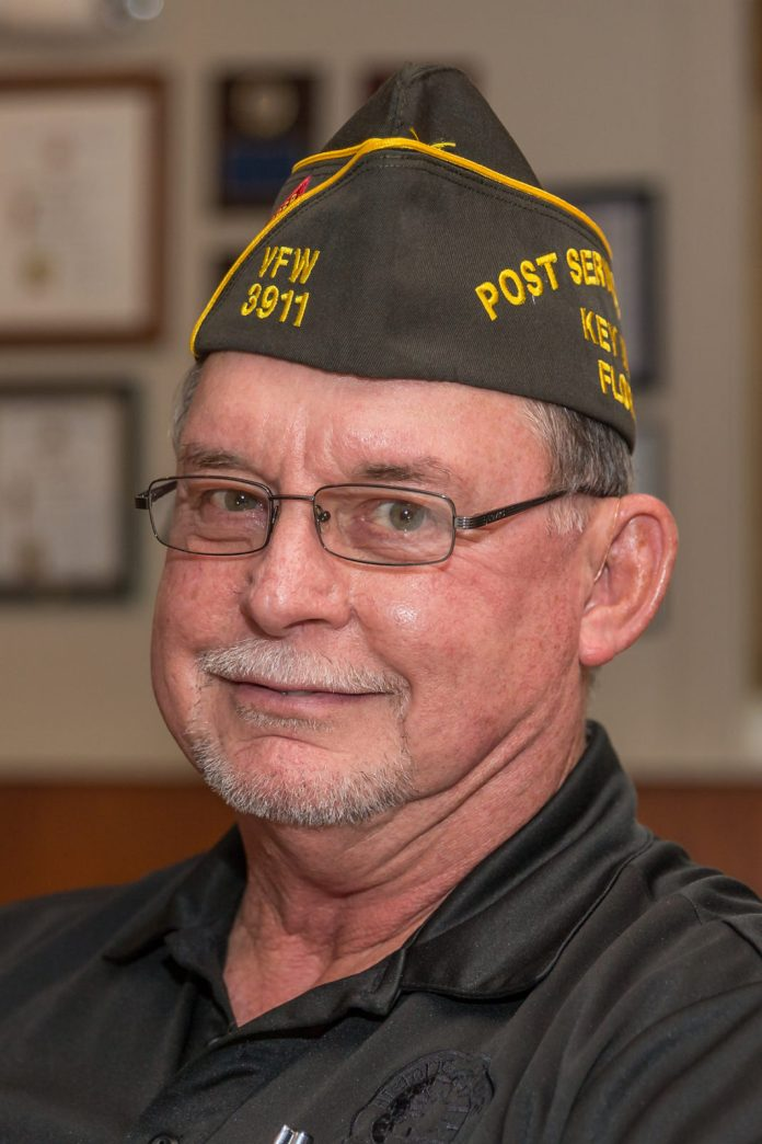 Keys Weekly honors local veterans - A man wearing a hat and glasses - Glasses