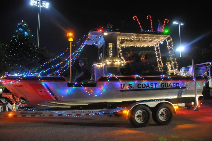 'CARING AND SHARING AROUND THE WORLD' – Hammon grand marshal of Islamorada Holiday Parade - A close up of a street at night - Car