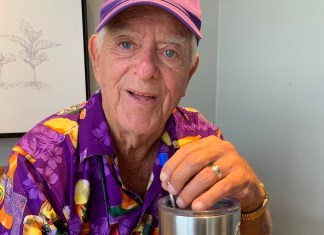 The Steel Strawman Saving The Environment 'One Sip At A Time' - A man wearing a hat - Purple