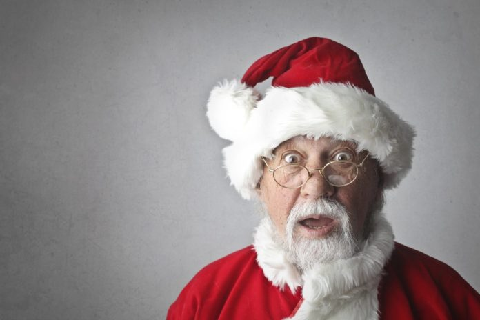 Top 10 worst philanthropic causes this holiday season - A man wearing a red hat - Santa Claus