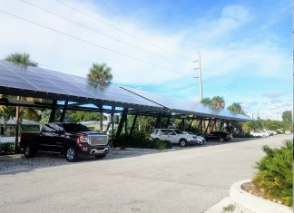 Solar panels save Key West $1,100/month - A car parked on the side of a road - Luxury vehicle
