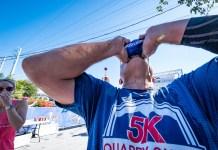 RUNNING THE ISLANDS - A man in a blue shirt - Water