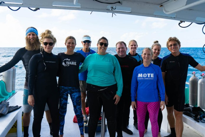 NOAA Launches $97 Million Targeted Mission to Save Florida Reef Tract - A group of people posing for a photo - Dry suit