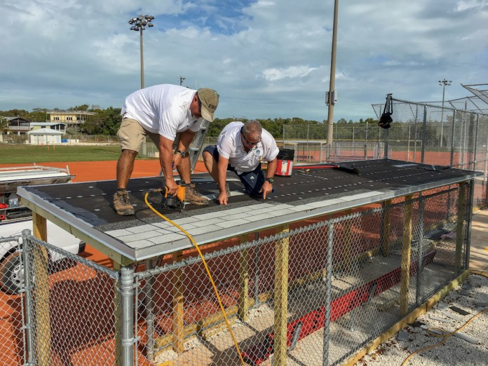 BUILDING, SUPPORTING AND EXCELING IN 2019 - A group of people standing on top of a metal fence - Key West International Airport