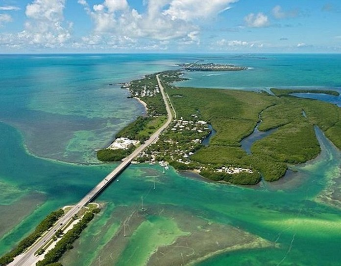 Municipalities proactive on flooding, sea level rise - A body of water next to the ocean - Florida Keys