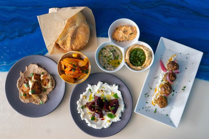 CREATIVE CUISINE – Enjoy spreads, pita bread, skewers at Meze Morada - A tray of food on a plate - Vegetarian cuisine