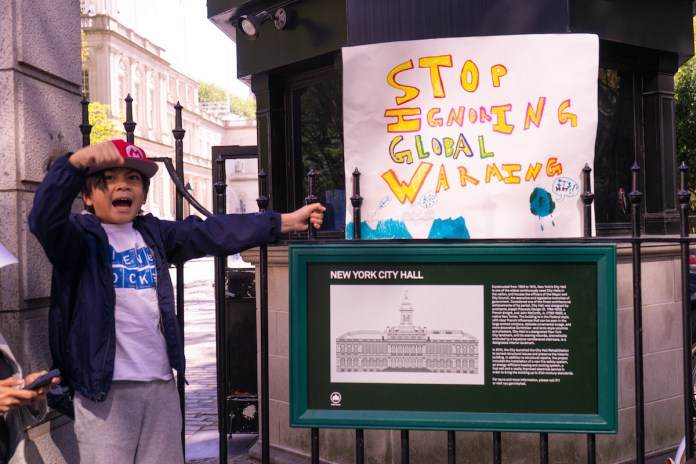 Kids from around the world are taking to the streets, sidewalks, and stairs in front of key government buildings to protest climate inaction by those in power. In New York City, they use metro stops and public spaces to get their message heard. TIFFANY DUONG/Keys Weekly