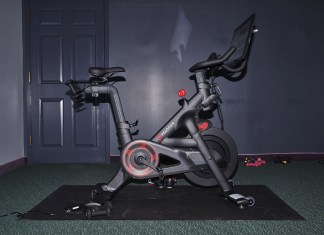Top 10 Gifts Worse than a Peloton - A motorcycle is parked on the side of the room - Bicycle
