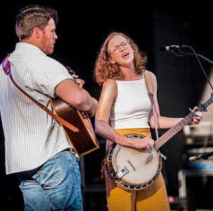 Eighth annual Baygrass Bluegrass set - A man and a woman standing on a stage - Bass guitar