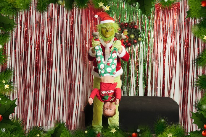 Photo contest winner shares happy update - A person standing next to a christmas tree posing for the camera - Christmas tree
