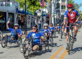 Key West welcomes 44 Wounded Warriors - A group of people riding on the back of a bicycle - Road bicycle racing