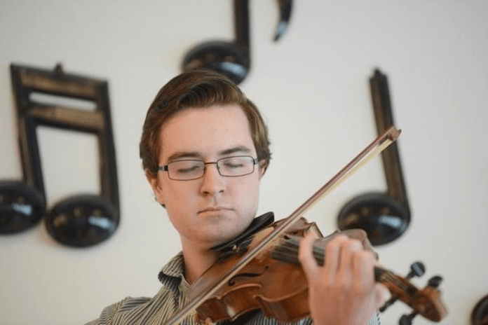 Listen to fiddler prodigy Connor Civatte at weekend's Celtic Festival - A person holding a violin - Violin