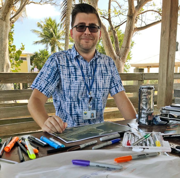 Brian Shea of the City of Marathon mans the table at Sombrero Beach to collect ideas for redeveloping the former Quay property, now a city park. More sessions are scheduled. SARA MATTHIS/Keys Weekly