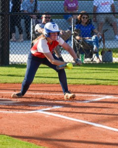 Colonial Christian's Morgan Wells lays down a bunt.