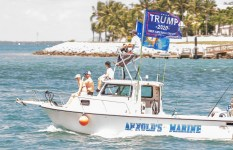 Key West native Ricky Arnold, owner of Arnold's Towing, is at the helm during Key West's Boat for Trump event. LARRY BLACKBURN/Keys Weekly