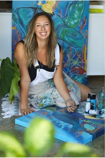 "Artist Jessica Ann Hessing with her ""In the reef"" collection, sales from which also benefit CRF. Hessing is inspired by the local marine life and the organizations working to conserve them. JESSICA ANN ART STUDIO/Contributed"