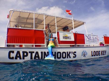 Mermaid Megan Brandenburg waves before descending into the deep, blue waters at Looe Key Reef. TIFFANY DUONG/Keys Weekly