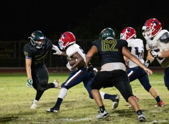 Coral Shores junior linebacker Dominick Monteagudo goes for the tackle against a Florida Christian runner.
