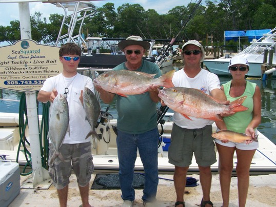 Dot Palm owners, John and Gigi Harrison, treated her parents, Jim and Ann Barfield, to a half day of yellowtailing on the reef