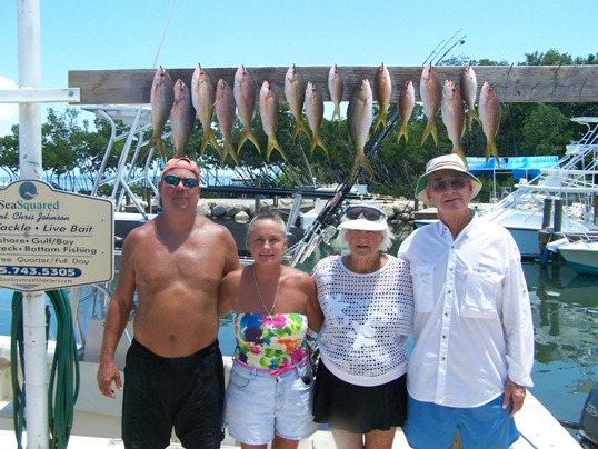 Back at the dock are Avery Kinard, Ray Wooten, Walter and Linda Kinard