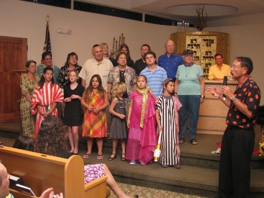 John Kreinces leads the Congregation B'nai Zion Hanukkah Singers