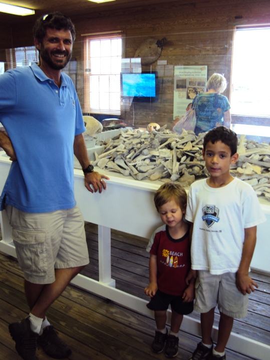 """Corey Malcom, Director of Archaeology with two-year old Austin Stotts and six-year old Landon Stotts. """"I'm the guy that digs up all these turtle bones you see here!"""" Corey explained his role"""