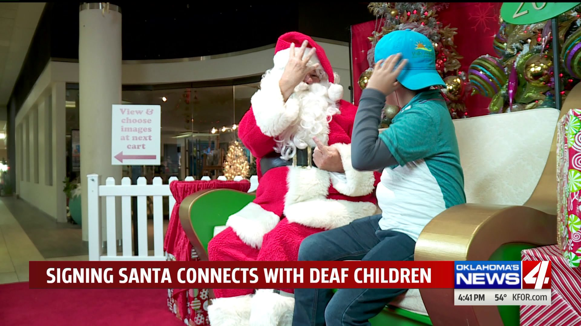 Santa signs with deaf/hoh children